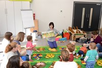 Author, Ellie Sandall reading to young children