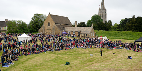 Crowds fill the grounds of the historic Oakham Castle